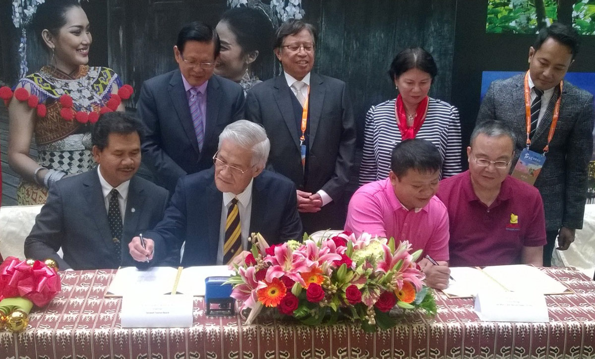 Picture shows Datuk Wahab seated second from left, flanked by Mr. Mark Chen on his left signing the MOU witnessed by Datu Ik seated at left and Mr. Chen (right). Also seen standing from left, Datuk Lee, Datuk Amar Abang Johari, Datuk Adeline and Ahmad Faisal.