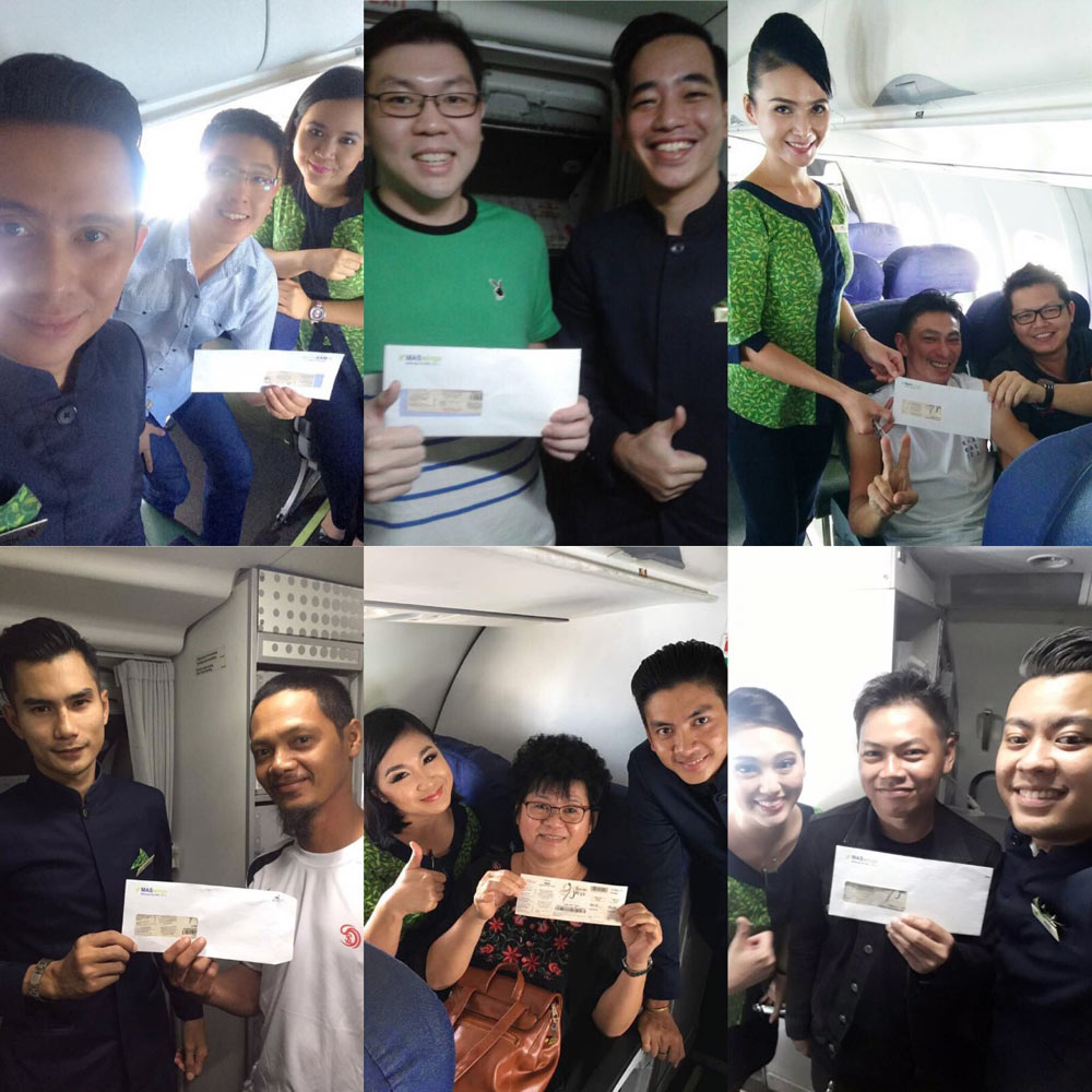 Image shows MASwings staff awarding passengers with tickets to Borneo Jazz Festival in Miri, after holding lucky draws on-board its flights in April.