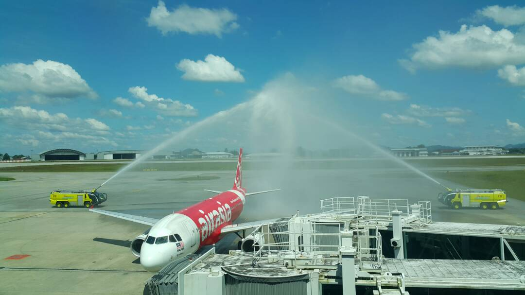 Image shows inaugural flight receiving water salute at Kuching International Airport.