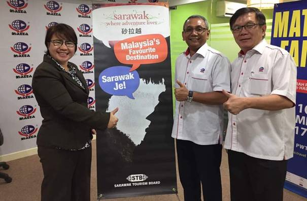 "From left: Acting Chief Executive Officer of Sarawak Tourism Board,  Mary Wan Mering, MATTA Fair Vice President, Mohd Akil Mohd Yusof and MATTA Chief Executive Officer, Phua Tai Neng, introducing the ""Malaysia's Favourite Destination"" banner."