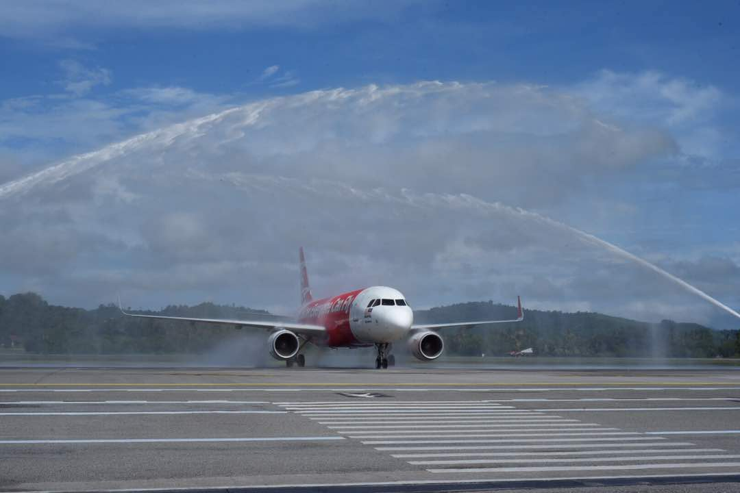 The arrival of the Kuching-Langkawi flight being officially welcomed by water salute at the Kuching International Airport